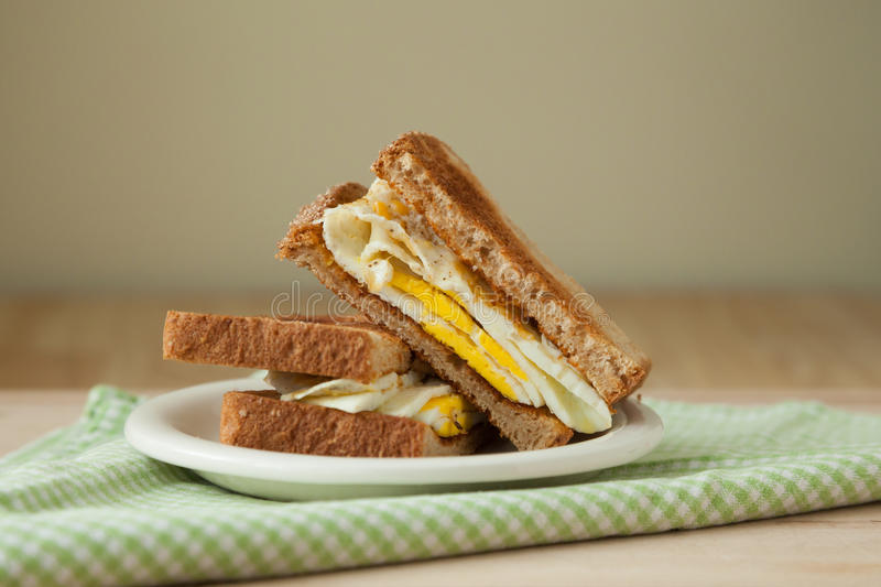 Fried Egg Sandwich on Whole Grain Toast royalty free stock photo