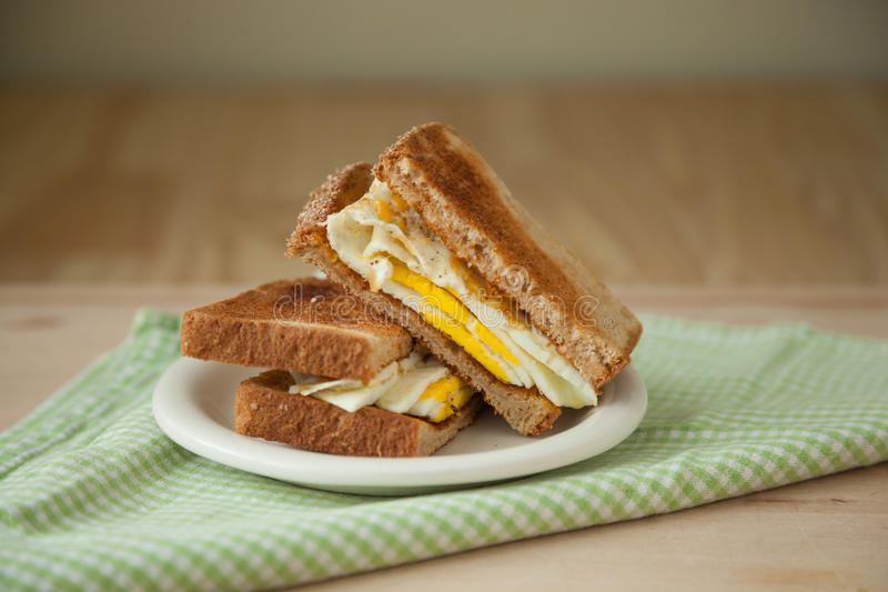 Fried Egg Sandwich on Whole Grain Toast royalty free stock image