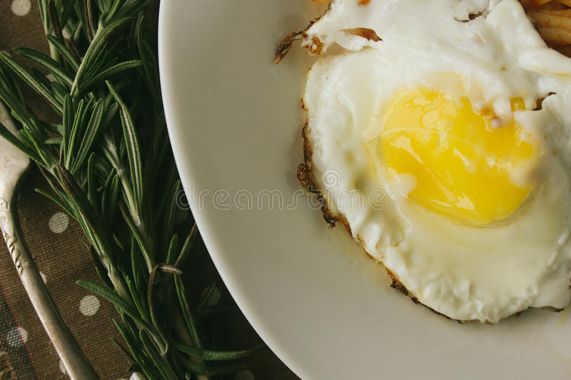 Fried egg and spaghetti rustic. Selective focus top view closeup stock photos