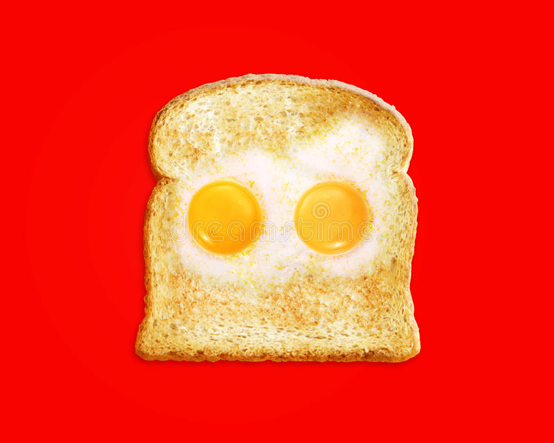 Fried egg with toast. On a Red background stock image