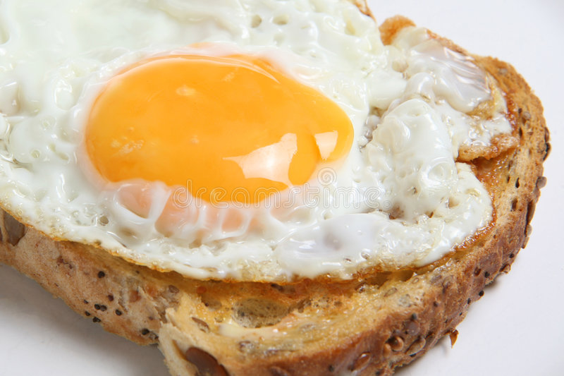 Fried Egg on Toast. Close-up of fried egg on wholemeal toast stock photography