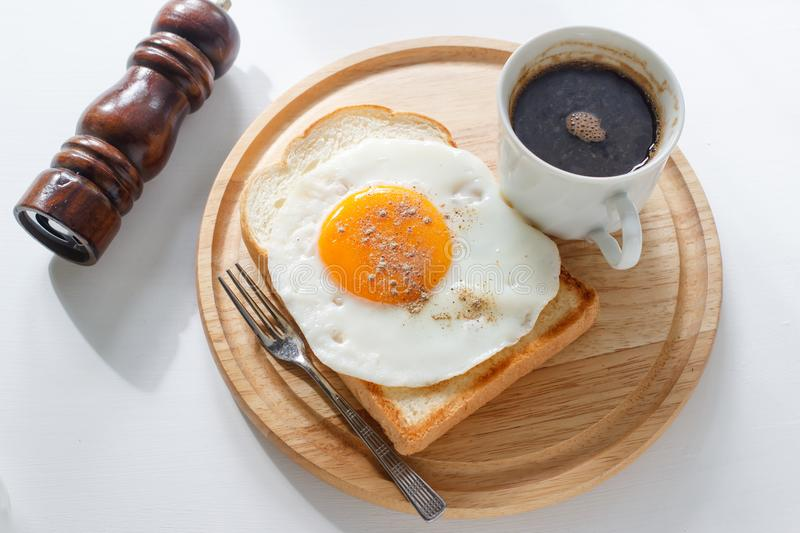 Fried egg on toast. Coffee on white background stock photo