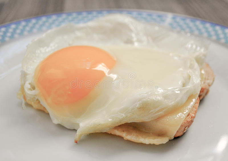 Fried egg on toast. Shot of a Fried egg on toast royalty free stock photography