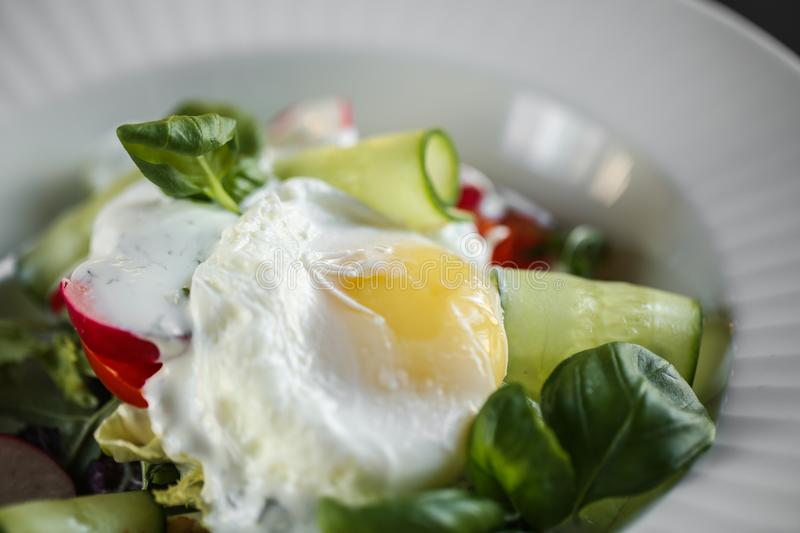 Fried Egg with vegetables on plate close up food photo.  stock images