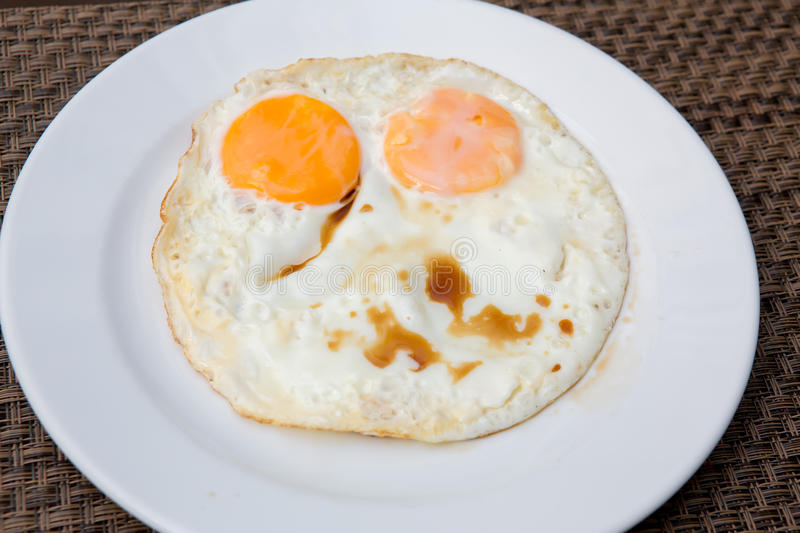 Fried Eggs. On a plate royalty free stock images