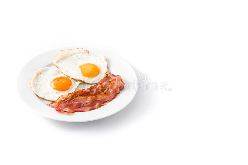 Fried eggs and bacon for breakfast isolated. On white background. Copyspace royalty free stock photo