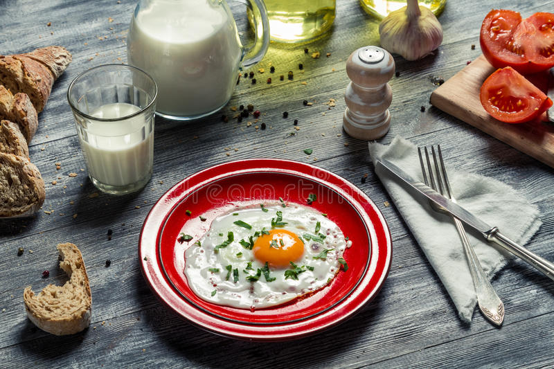 Fried eggs, bread and milk for breakfast stock photo
