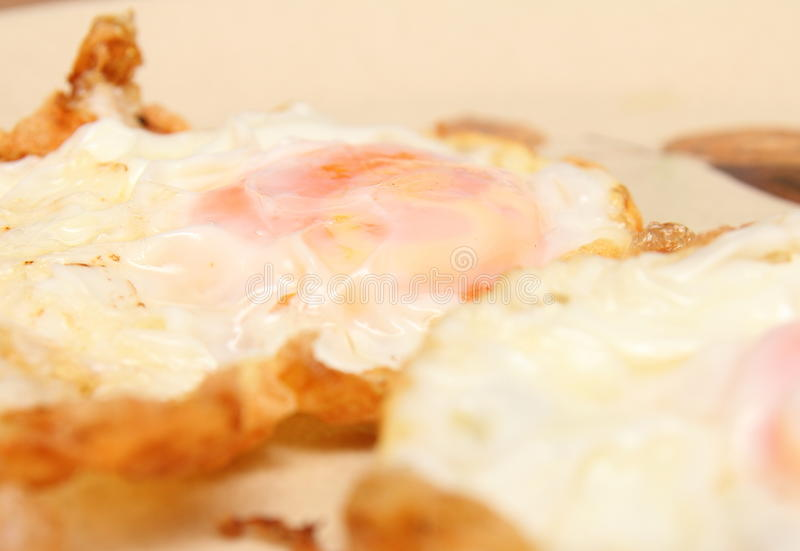 Download Fried Eggs On A Hot Plate Stock Photo - Image: 83700769