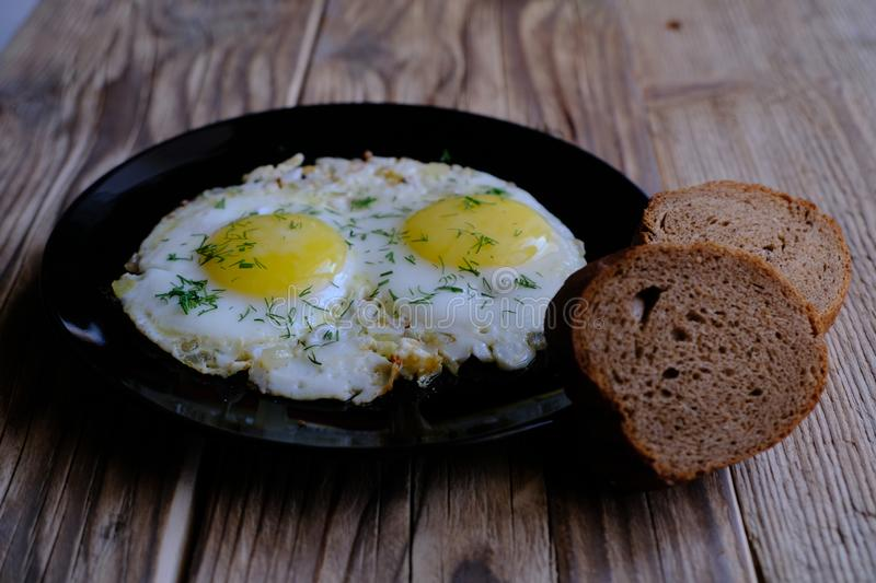 Fried Eggs on a plate royalty free stock image