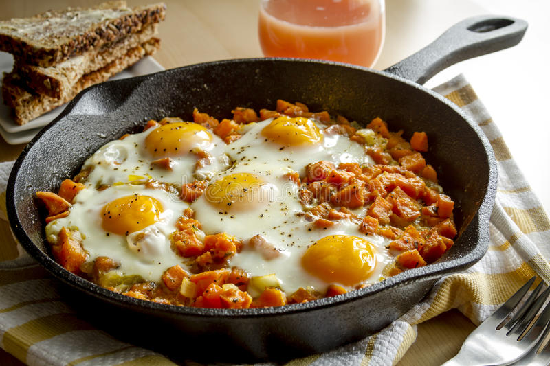Fried Eggs and Sweet Potato Hash stock photography
