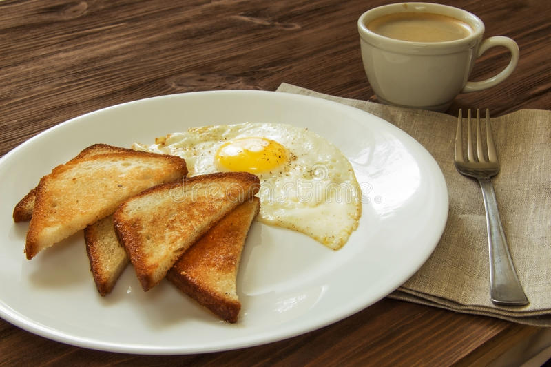 Fried eggs with toast. And coffee stock image