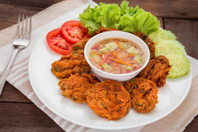 Fried fish cake and vegetables on plate, Thai food stock photography