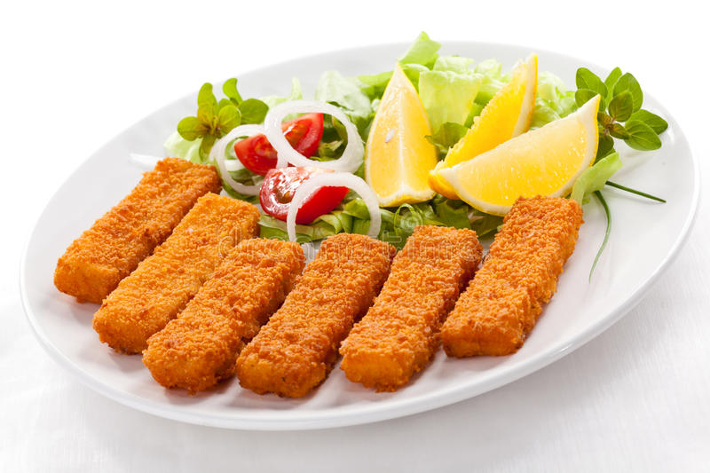 Fried fish fingers stock photography