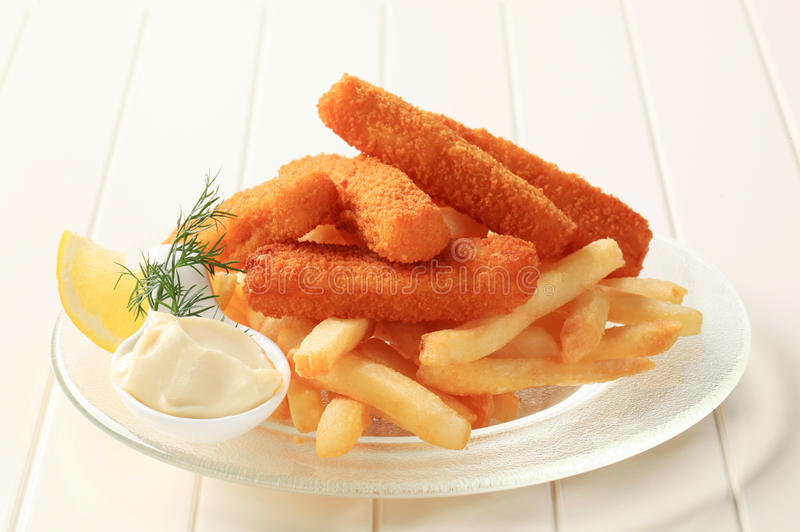 Fried fish fingers and French fries royalty free stock photography