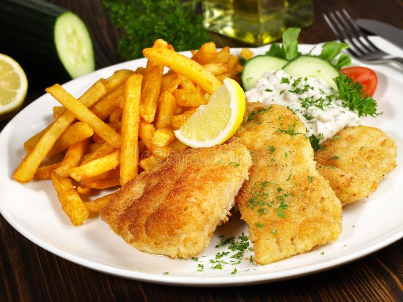 Fried Fish with French Fries. On wooden Background royalty free stock images