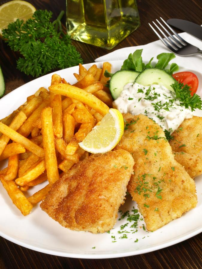 Fried Fish with French Fries - Upright format. Fried Fish with French Fries and Lemon royalty free stock image