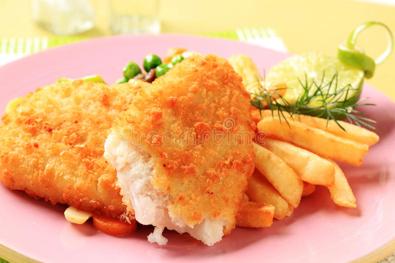 Fried fish and French fries stock photos