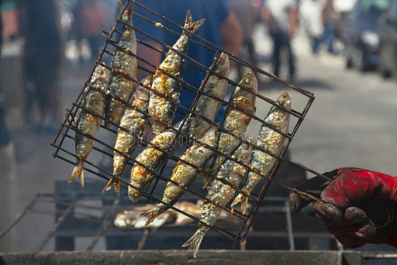 Fried fish on a hot coal. stock photos