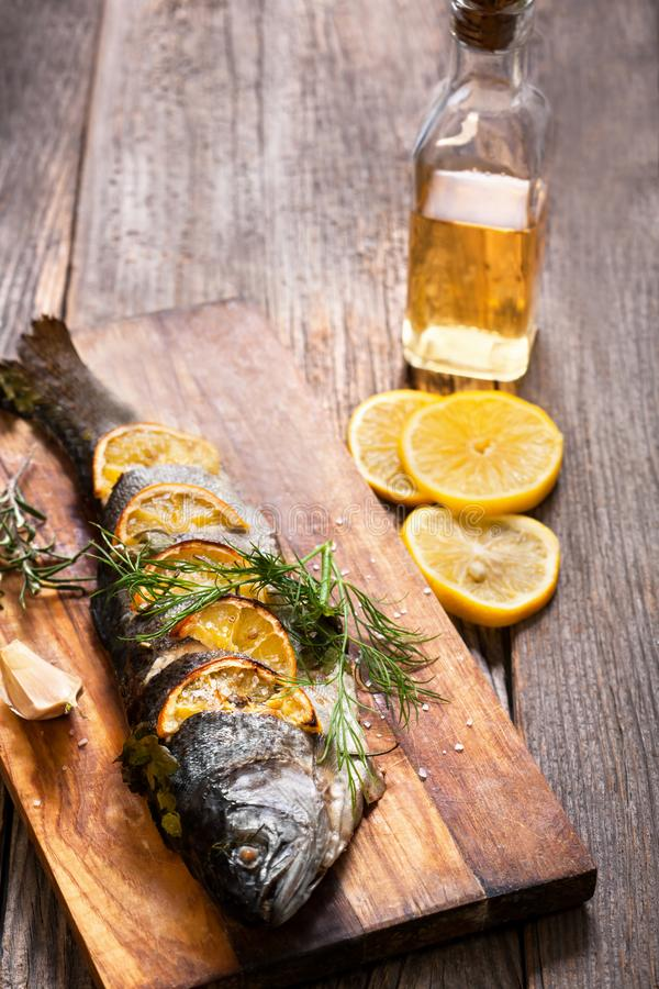 Fried fish with olive oil and vegetables royalty free stock photo