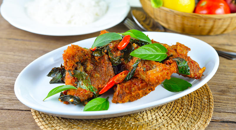 Fried fish with red chilli sauce,Thai food royalty free stock photo