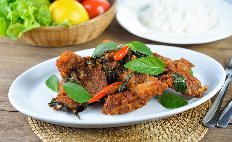 Fried fish with red chilli sauce on white plate stock images