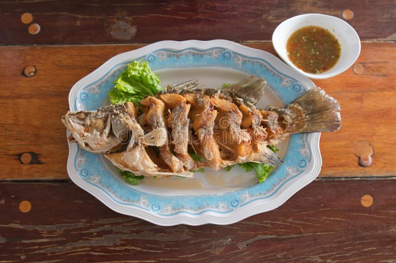 Fried Fish with Fish Sauce royalty free stock photo