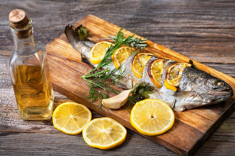 Fried fish with a slice of lemon royalty free stock image