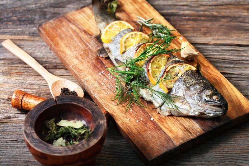 Fried fish with spices and lemon royalty free stock images