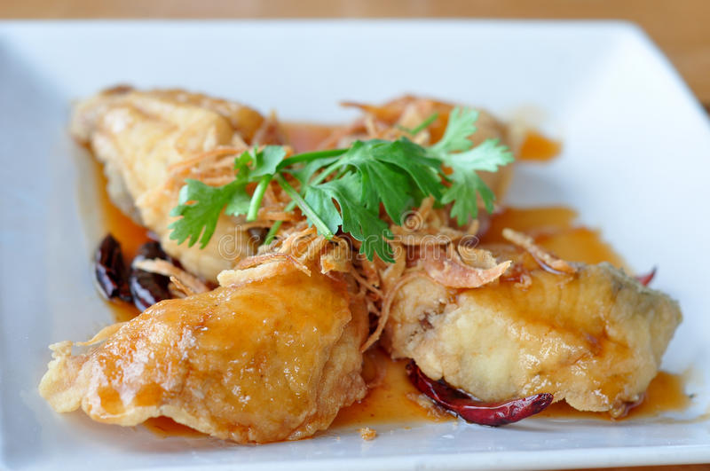 Fried fish with sweet and sour sauce. stock photo