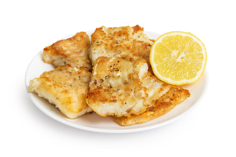 Fried in flour codfish on plate royalty free stock image