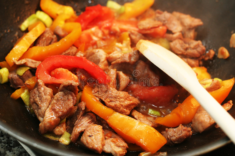 Fried food. Vegetables with beef - fried mixed food stock photos