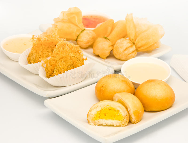 Fried food in Dim Sum restaurant. Fried sweet cream bun. Fried taro with chicken.Toong-Thong (1 kind of spring rolls stock images