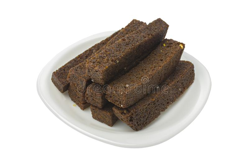 Fried garlic toasts. Black bread on a white plate. White background. Isolated stock image