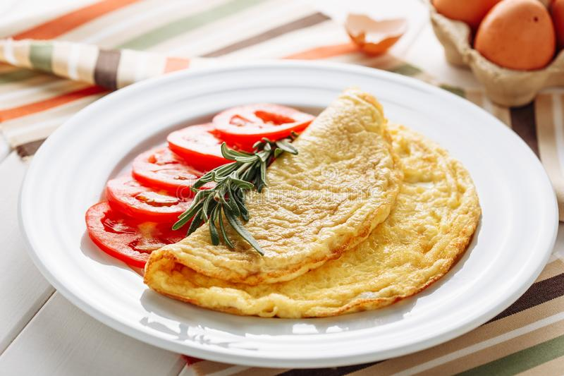 Fried Greasy Omelette Tomato for Healthy Breakfast royalty free stock image