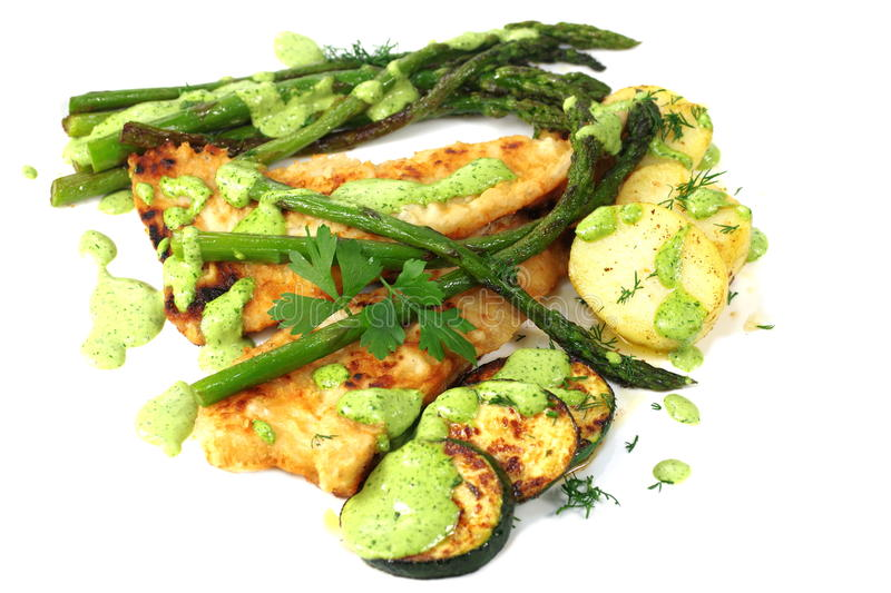 Fried green asparagus in plate. With fish royalty free stock photography