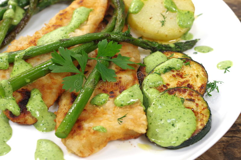 Fried green asparagus in plate. With fish stock photo