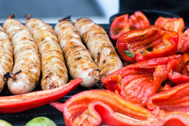 Smoked vegetables, sausages, grilled sausages stock photos