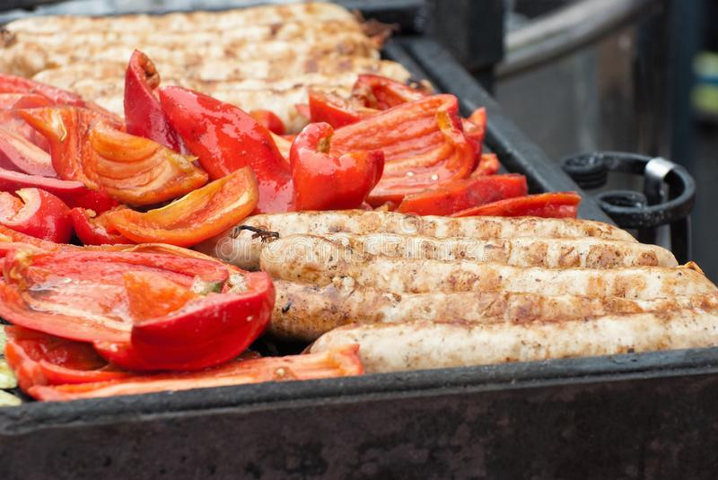 Fried, on the grill, vegetable and meat sausages. stock image