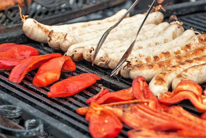 Smoked vegetables, sausages, grilled sausages royalty free stock image