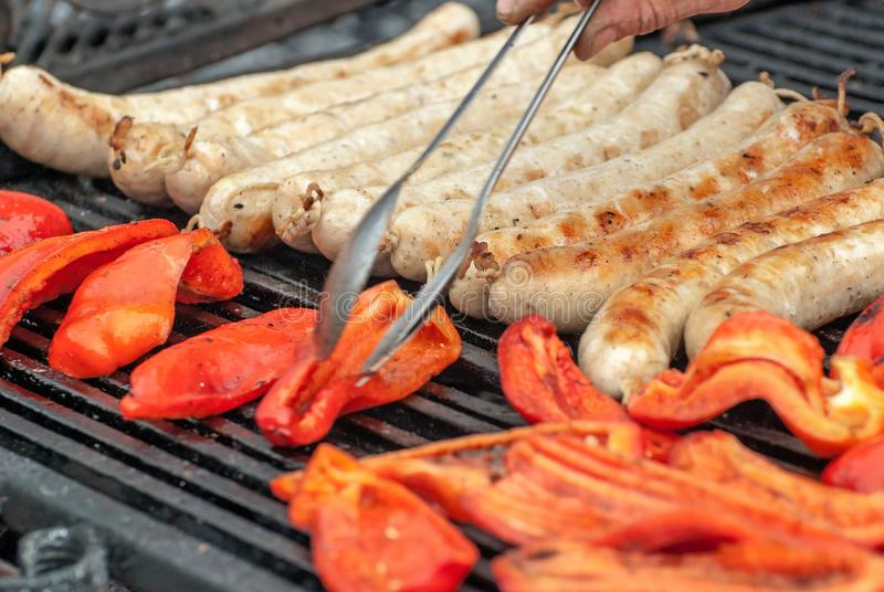 Fried, on the grill, vegetable and meat sausages. stock photo