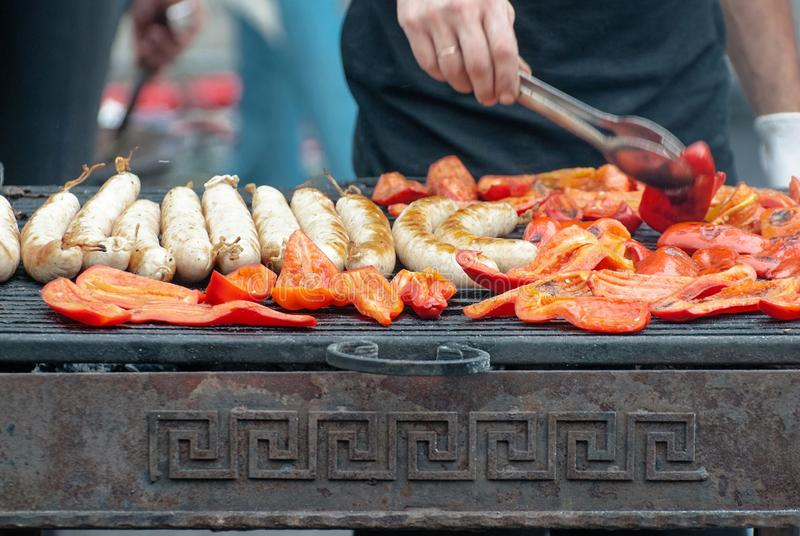 Smoked vegetables, sausages, grilled sausages royalty free stock images