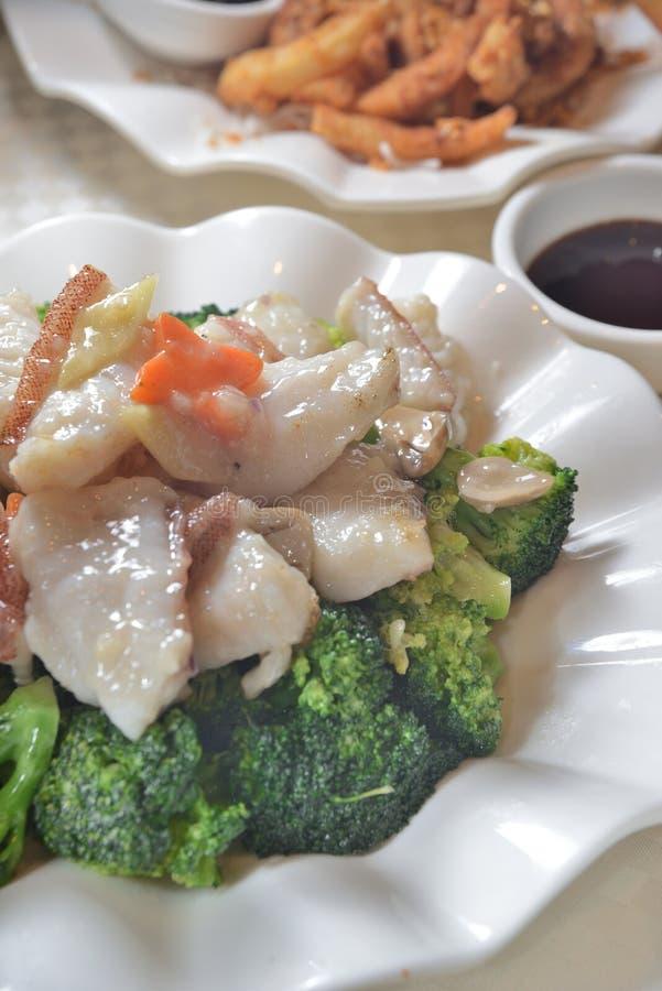 Fried grouper broccoli royalty free stock photos