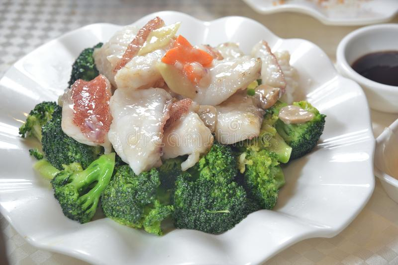 Fried grouper broccoli stock images