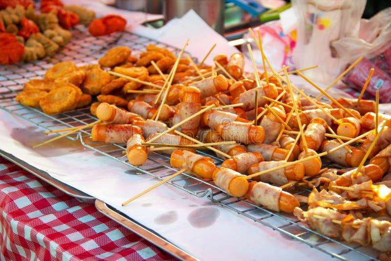 Fried hotdog with ham wrap around. Junk food. Street food stock images