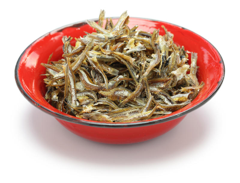 Fried ikan bilis(dried anchovies) , malaysian food. Fried ikan bilis(dried anchovies) in bowl isolated on white background stock photo