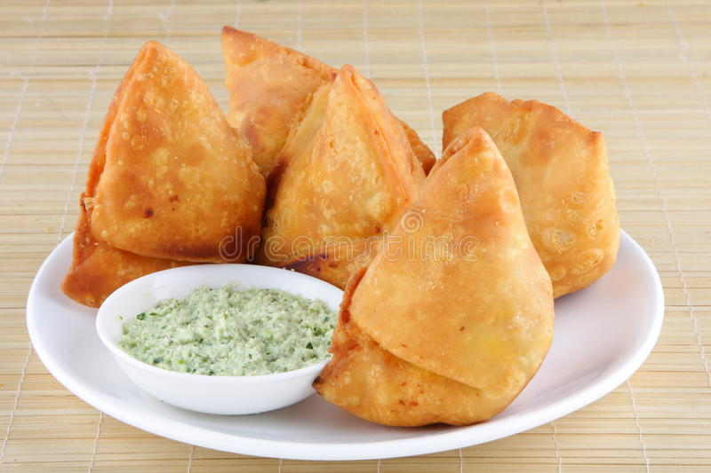 Fried Indian Samosa with coconut chutny. royalty free stock photos