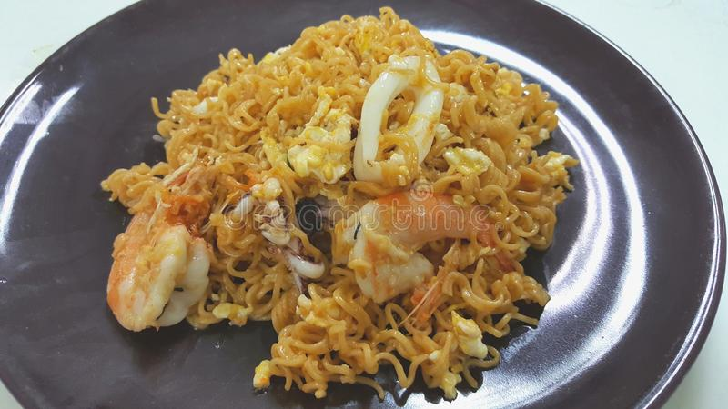 Fried instant noodle with seafood stock photography