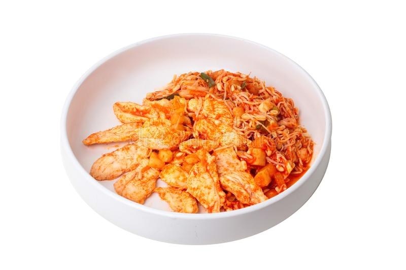 Fried kimji with skinless chicken in korean white plate. Isolated of fried kimji with skinless chicken in korean white plate served on wood royalty free stock photography