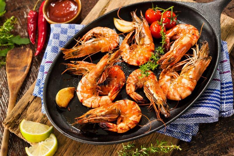 Fried king prawns. On iron pan stock photography