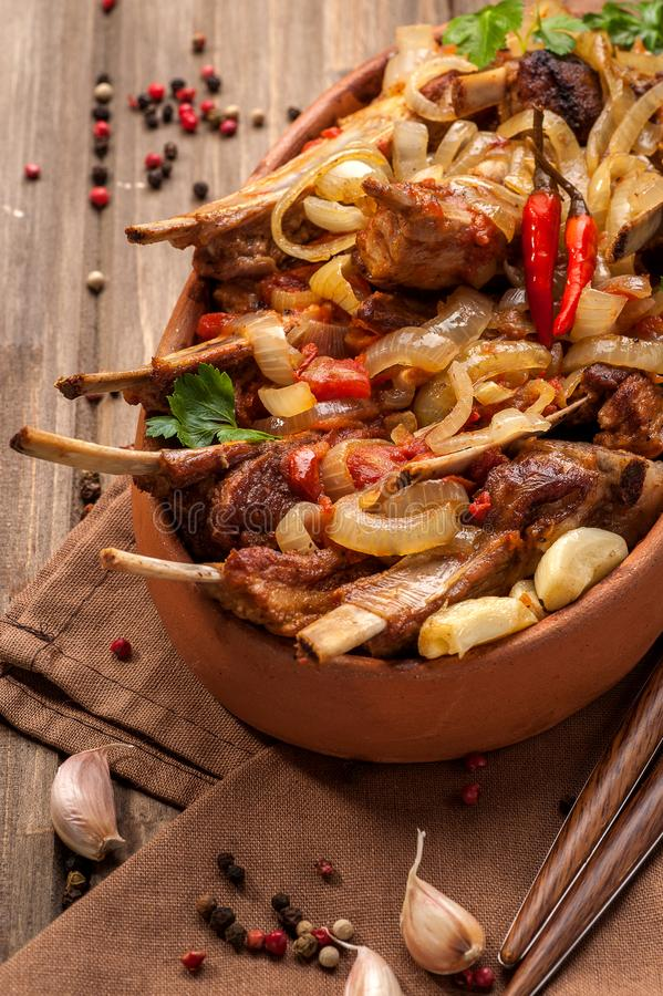Fried lamb chops with fried onions royalty free stock image